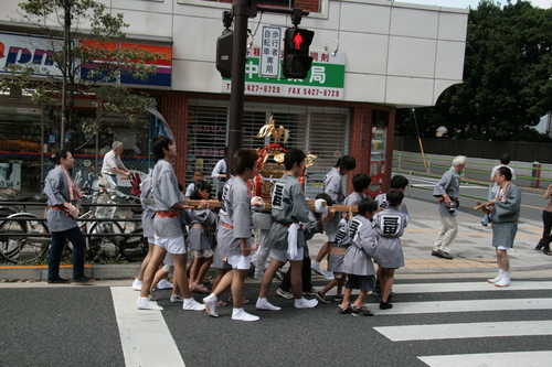 [Picture: Carring the Mikoshi 2]