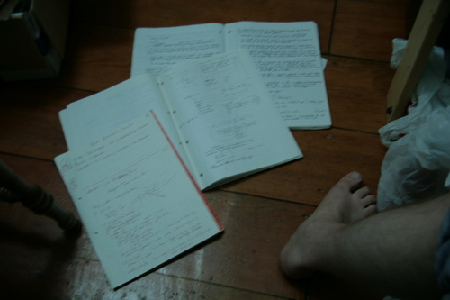 [Picture: Blurry notebooks]