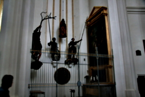 [picture: Side-chapel with dangling figures]