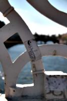 [picture: A small sticker on the pedestrian bridge]